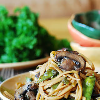 Spicy Asian noodles and mushrooms, with snow peas.