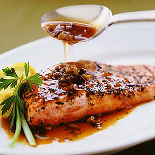 Pepper-Crusted Salmon with Olive Sauce.