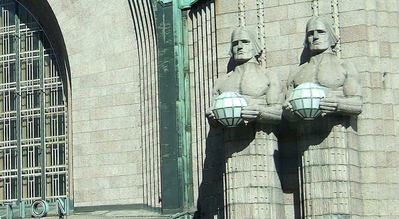 Lantern bearers on the Central Railway Station in Helsinki, Finland.