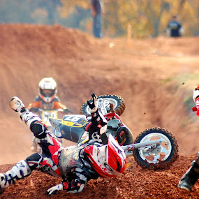 Crash on the race track by Tony Moore - Sports & Fitness Motorsports ( safety, mud, 2007, young boys, sports, motorcycle, mx, helmet, young riders, alexander county, crash,  )
