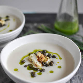 Creamy Cauliflower Soup with Crispy Capers and Chive Oil.