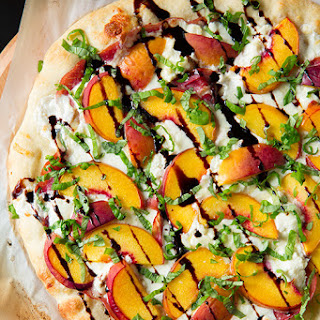 Three Cheese Peach and Prosciutto Pizza with Basil and Honey Balsamic Reduction.