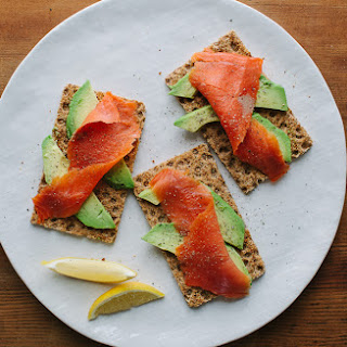 Avocado on Rye Crackers with Smoked Salmon.