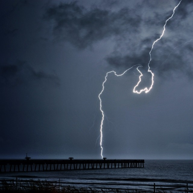 Super Charged Lightning Bolt at the fishing pier in Jacksonville Florida. by Berry Fraley - Landscapes Weather