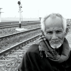 Journey by Bhaskar Kalita - People Portraits of Men ( life, black and white, railroad, journey, old man, man )