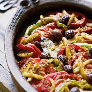 Moroccan Fish Tagine with Tomatoes, Olives, and Preserved Lemons.