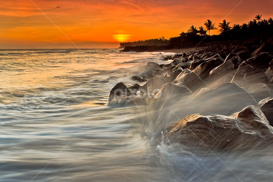 Splashing on Rocks by Choky Ochtavian Watulingas - Landscapes Sunsets & Sunrises ( clouds, boulders, waterscape, sunset, trees, csv, beach, seascape, rocks, sun )