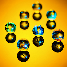 marbles by Pravin Dabhade - Artistic Objects Other Objects ( marbles, canon.relection.gold, yellow )