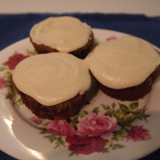 Gluten, Dairy and Egg Free Over-spiced Carrot Cupcakes with Orange Icing.