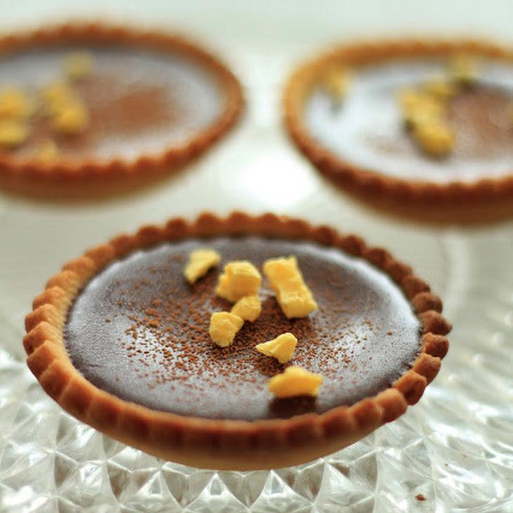 Orange Curd Tartletts With Chocolate Ganache.
