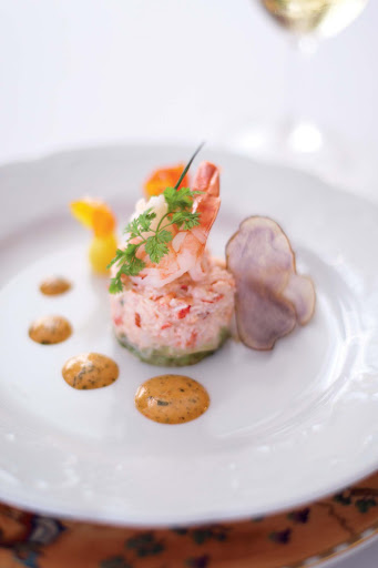 A lobster salad starts off an elegant meal aboard the Crystal Serenity.