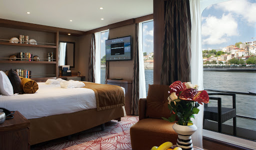 AmaVida-suite - Wake up in your suite to scenic views of Portugal. The 106-passenger AmaVida features balconies in the majority of its staterooms, which range up to 323 square feet.