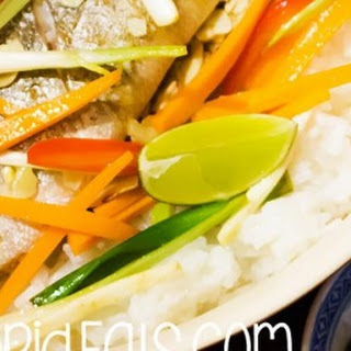 Steamed Sea Bass In Foil With Vegetables And Rice.