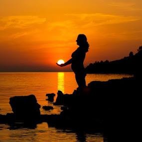 expecting new life by Darko Kovac - People Maternity ( water, child, maternity, woman, sunset, new life, croatia, pregnant, sea, kaprije, sun, , landscape, beach, silhouette )