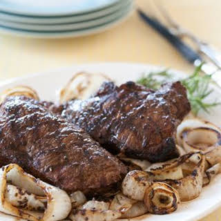 Grilled Bison Strip Steaks with Sweet and Sour Onions.
