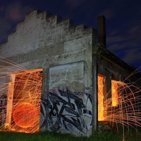Hard at the forge by Jamie Rabold - Abstract Light Painting ( canon camera, june, lighting effects, minnesota point, spinning fire, ball of light, light art, abandoned building, spinning, steel wool, leds, graffiti, duluth mn, sparks, night sky, led orb, grass, mn point, park point, old building, 50d, lighting graffiti, light painting, led, orb, night, wild lights, night light. flying sparks,  )
