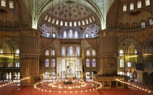 interior-Blue-Mosque-Istanbul - An interior view of the Sultanahmet Camii, or Blue Mosque, in Istanbul, Turkey.