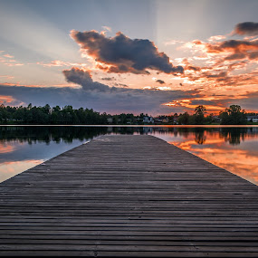 Sjögardssjön by Colin Harley - Landscapes Sunsets & Sunrises ( water, clouds, reflection, village, lake, rays )