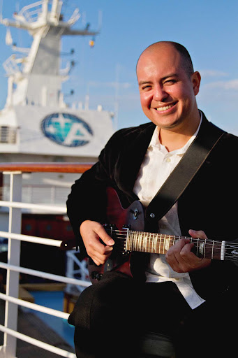 Azamara-Victor-guitarist - Victor performs during an Azamara cruise, helping to make your voyage nice and smooth.