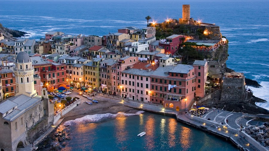 Vernazza, Italy at dusk. by Gale Perry - City,  Street & Park  Vistas ( colorful, relax, park at night, sassy, lights, tranquil, night life, street at night, hot pink, pink, colored, city at night, nightlife, mood, scents, scenic, fun, relaxing, nighttime in the city, lighting, confident, tranquility, artificial, senses, mood factory,  )