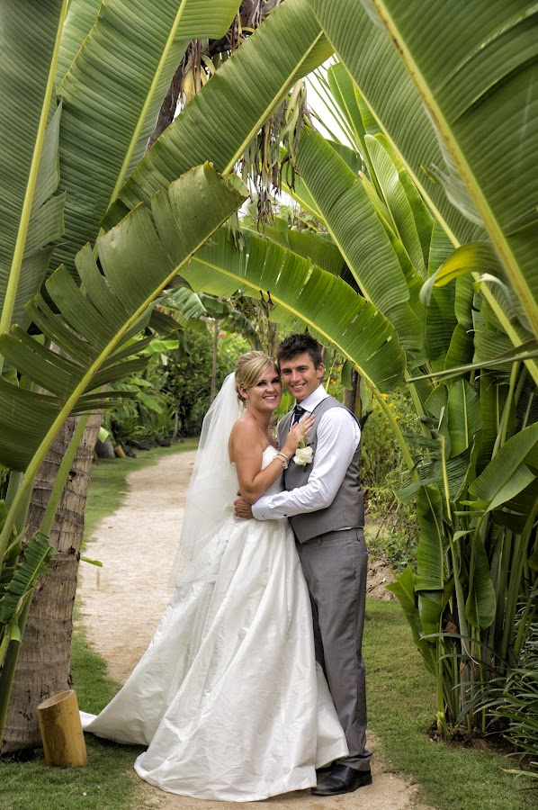 under the banana leaf by Frans Widi - People Couples