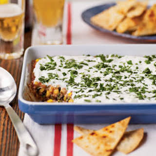 Party Bean Dip with Baked Tortilla Chips.