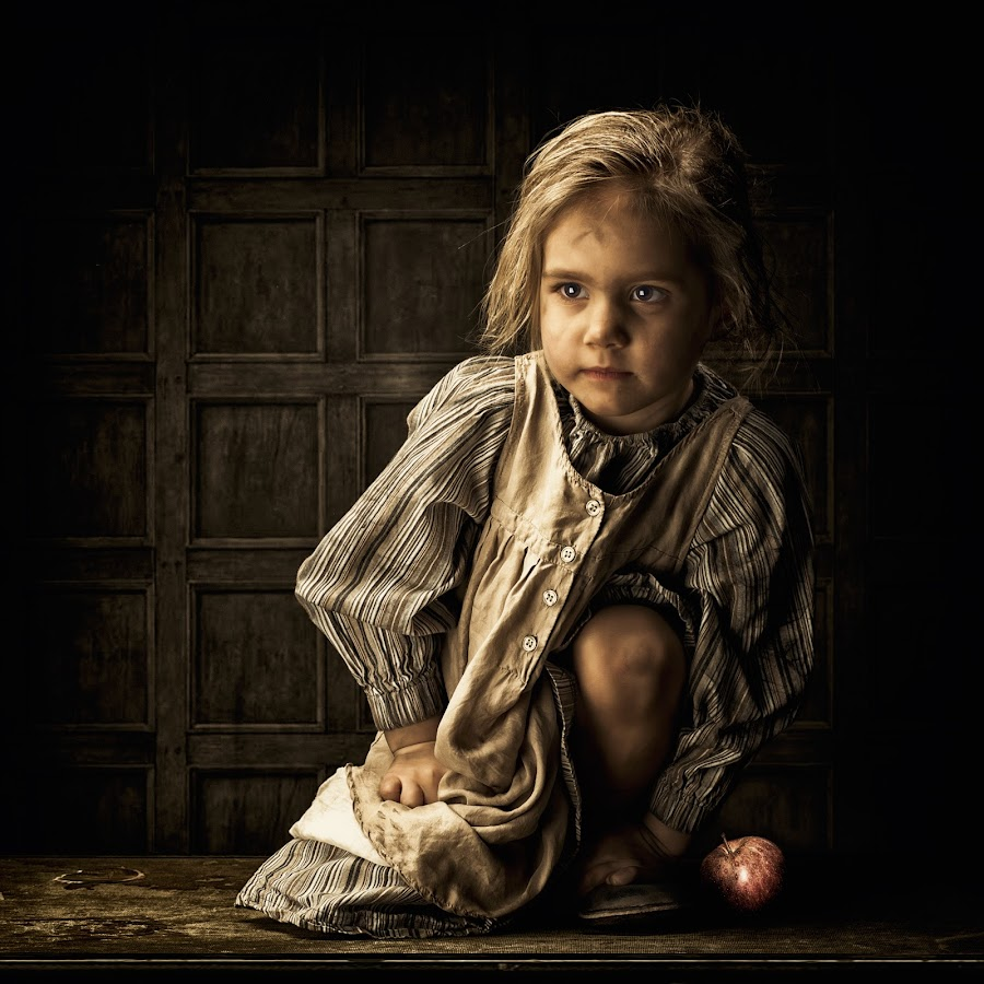 The girl with the apple  by Jan Kraft - Babies & Children Child Portraits ( colour, girl, sadness, vintage, apple, hair )