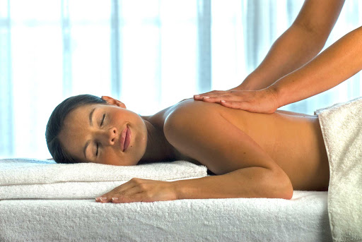 A massage from a trained masseuse at Voyager of the Seas' full-service Vitality Spa can revitalize the mind and body.