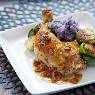 Pan-Seared Chicken Legs with Purple Smashed Potatoes, Brussels Sprouts & Warm Bacon Vinaigrette.