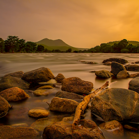 Feel the Tide by Vamsi Korabathina - Landscapes Waterscapes ( tides, sunset, waves, long exposure, evening, river )