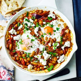 Baked Eggs And Spicy Red Pepper Beans With Feta.