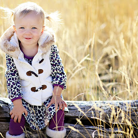 Pigtails in tall grass by Kristin Cheatwood - Babies & Children Toddlers ( leopard print, pigtails, toddler, tall grass, log )