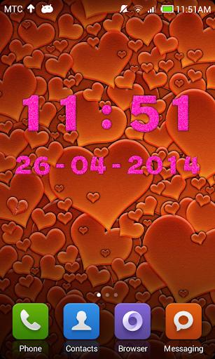 ピンクのデジタル時計