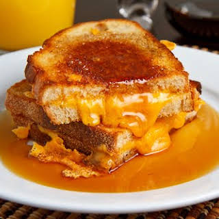 Breakfast Grilled Cheese Sandwich with Maple Syrup.
