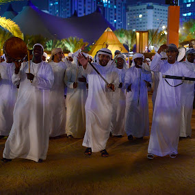 Good times by CJ Cantos - News & Events Entertainment ( night photography, colors, entertainers, festival, abu dhabi, people )