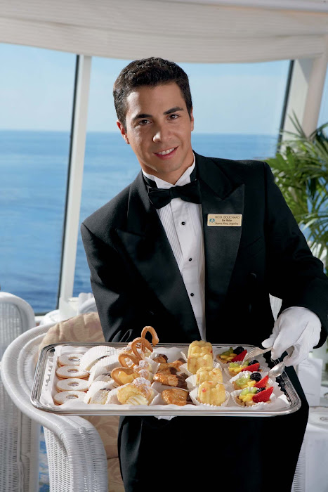 Teatime waiters provide light treats on Crystal Symphony.