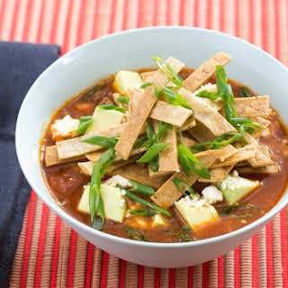 Beef & Pinto Bean Chili with Crispy Tortilla Strips, Avocado & Cotija Cheese.