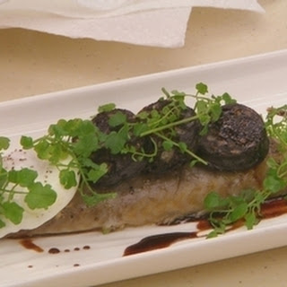 Smoked Mackerel With Black Pudding, Poached Egg And Port Sauce.