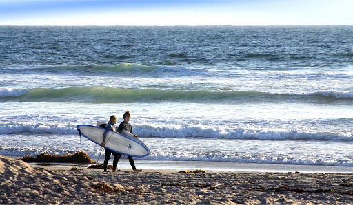 Surfers on Mission Beach, San Diego.