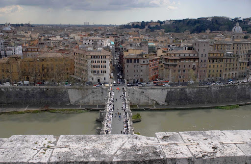 View-Castel-Sant'Angelo-Rome - Looking down on the Ponte Sant'Angelo and the Tiber River from the top of Castel Sant'Angelo, Campo Marzio, Rome.
