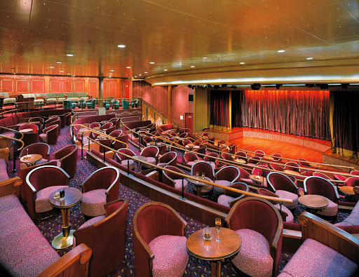 Silversea_theater-1 - The plush theater aboard Silver Shadow is big enough for Broadway-style shows. Performances take place daily.