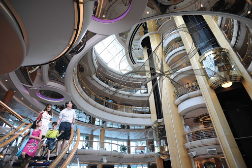 Grandeur-of-the-Seas-Atrium-Family - The hub of Grandeur of the Seas is the Centrum, a sweeping six-story atrium.