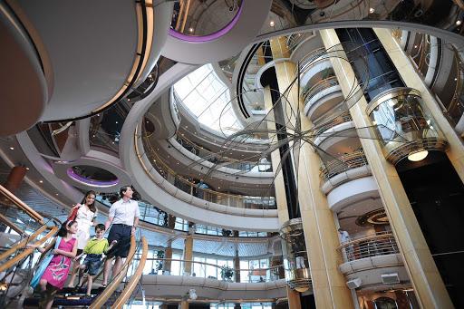 Grandeur-of-the-Seas-Atrium-Family - The hub of Grandeur of the Seas is the Centrum, a sweeping six-story atrium.