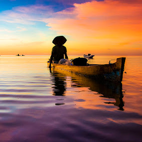 A Half into the Water by Sonny Saban - Transportation Boats ( sunsets, sea, beach, travel, people, rote island )