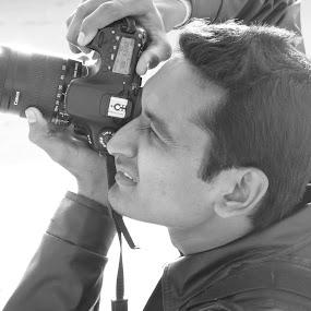 Focus_1 by Rahul Savaliya - People Street & Candids ( point, new, color, aim, camera, white, photographer, candid, focus, dof, black, eye,  )