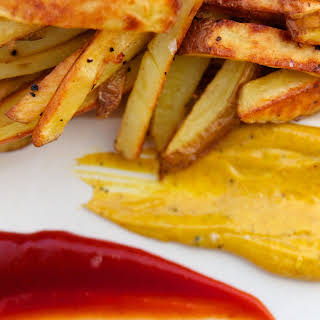 Olive Oil Roasted Fries with Curry Mayo & Spicy Ketchup.