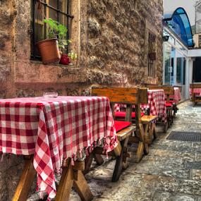 Budva by Branislav Rupar - City,  Street & Park  Street Scenes ( tables, table linen, chairs, street, service, stones, restaurant, sidewalk )
