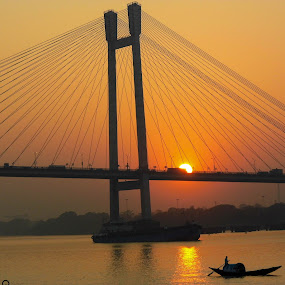 Sunset glory by Caesar Jees - Buildings & Architecture Bridges & Suspended Structures ( water, sunset, people.city.river, bridge, boat, sun )