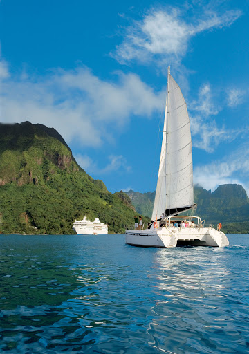 Paul Gauguin guests ply the waters of French Polynesia aboard a catamaran.