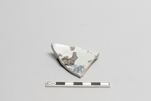 Base of small bowl or dish, adhering kiln debris